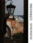 old streetlamp in alleyway ... | Shutterstock . vector #1298063386