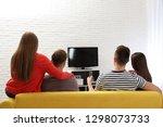 group of people watching tv... | Shutterstock . vector #1298073733