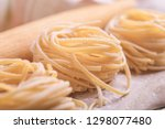 raw pasta on a wooden board | Shutterstock . vector #1298077480