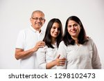 senior indian couple with young ... | Shutterstock . vector #1298102473