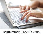 woman sitting at desk and... | Shutterstock . vector #1298152786