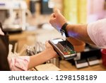 person paying at cafe with... | Shutterstock . vector #1298158189