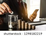 businessman holding coins... | Shutterstock . vector #1298182219