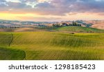 Majestic Panoramic view of typical Tuscany countryside nature landscape. Beautiful hills at the sunrise time, cypresses, fields and rural road. Italy, Europe - stock photo