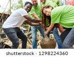 young volunteer team is... | Shutterstock . vector #1298224360