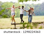 young team helps balance on a...   Shutterstock . vector #1298224363