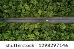 Small photo of Road through the green forest, Aerial view road going through forest, Aerial top view forest, Texture of forest view from above, Ecosystem and healthy environment concepts and background.