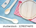 wooden kitchenware on gray... | Shutterstock . vector #1298374693