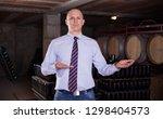 male winemaker giving tour... | Shutterstock . vector #1298404573