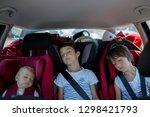 children travel in car seats in ... | Shutterstock . vector #1298421793