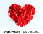 Stock photo beautiful heart shape made from fresh red rose petals isolated on white background decoration for 1298462353