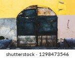 old door of the building in... | Shutterstock . vector #1298473546