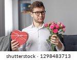 attractive guy in white shirt...   Shutterstock . vector #1298483713