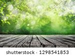 wooden table and spring grass... | Shutterstock . vector #1298541853