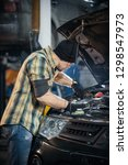 car service. brutal mechanic... | Shutterstock . vector #1298547973