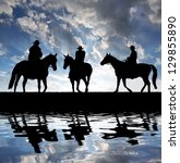 Silhouette Cowboys With Horses...