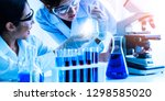 group of scientists wearing lab ... | Shutterstock . vector #1298585020