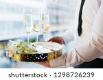 waiter serving tray with... | Shutterstock . vector #1298726239