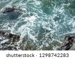 waves splashing against the... | Shutterstock . vector #1298742283