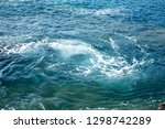 waves splashing against the... | Shutterstock . vector #1298742289
