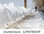 a person walking through the... | Shutterstock . vector #1298785039