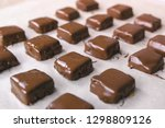 handmade chocolate candies on... | Shutterstock . vector #1298809126