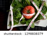 tomato and spinach. diet ... | Shutterstock . vector #1298838379