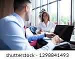 happy business colleagues in...   Shutterstock . vector #1298841493