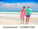 happy young couple walking and... | Shutterstock . vector #1298847283