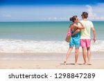 happy young couple walking and... | Shutterstock . vector #1298847289