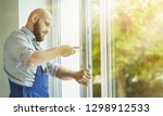 young repairman fixing window... | Shutterstock . vector #1298912533