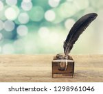 Stock photo quill pen with inkwell pen feather old 1298961046
