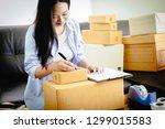 beautiful young asian business... | Shutterstock . vector #1299015583
