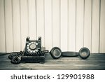 vintage telephone on old table... | Shutterstock . vector #129901988