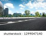 long empty footpath in modern... | Shutterstock . vector #1299047140