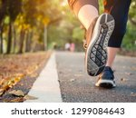 woman run in park outdoor trail ... | Shutterstock . vector #1299084643