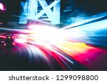 abstract motion blur in city in ... | Shutterstock . vector #1299098800