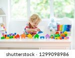 kid playing with colorful toy... | Shutterstock . vector #1299098986