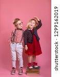 little children measuring the... | Shutterstock . vector #1299162019
