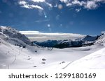 a wonderful day on the snow at... | Shutterstock . vector #1299180169