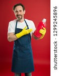 cleaning day today. bearded guy ... | Shutterstock . vector #1299245896