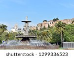 fountain with alcazaba castle... | Shutterstock . vector #1299336523