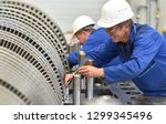 workers assembling and quality... | Shutterstock . vector #1299345496