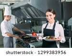 restaurant kitchen. waiter with ... | Shutterstock . vector #1299383956
