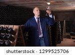 confident male winemaker... | Shutterstock . vector #1299525706
