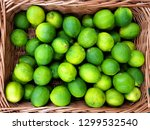 limes in a wicker basket | Shutterstock . vector #1299532540