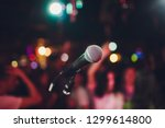 microphone against blur on... | Shutterstock . vector #1299614800