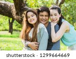 a daughter and parents relax in ... | Shutterstock . vector #1299664669