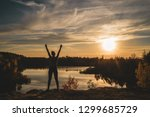 young girl stands and... | Shutterstock . vector #1299685729