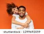 young african american couple... | Shutterstock . vector #1299692059